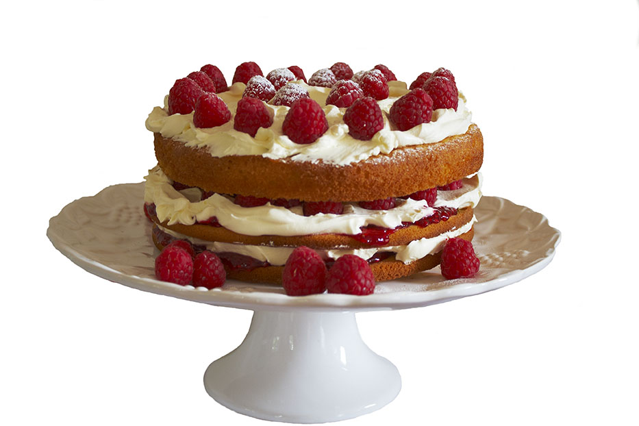 Picture of a huge cream and sponge cake with raspberries