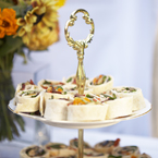 Vintage tiered cake stand with roast vegetable catherine wheel wraps