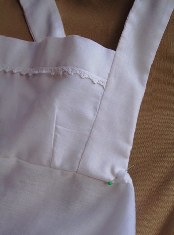 details of my white empire line apron