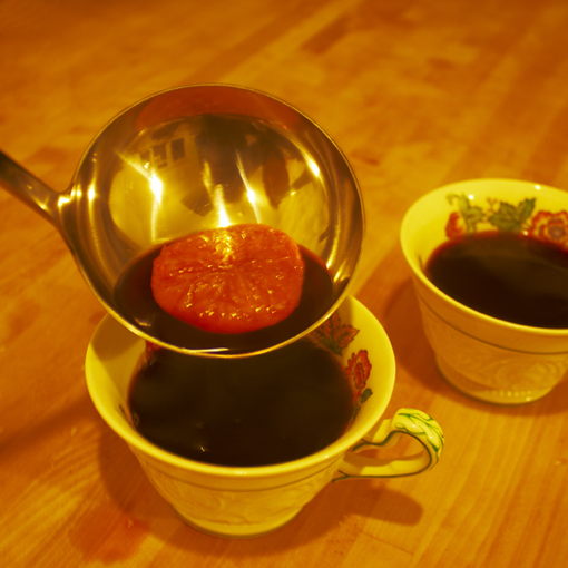 mulled wine poured into vintage teacups