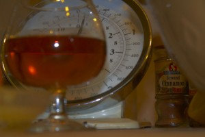 Glass of rum and cooking scales