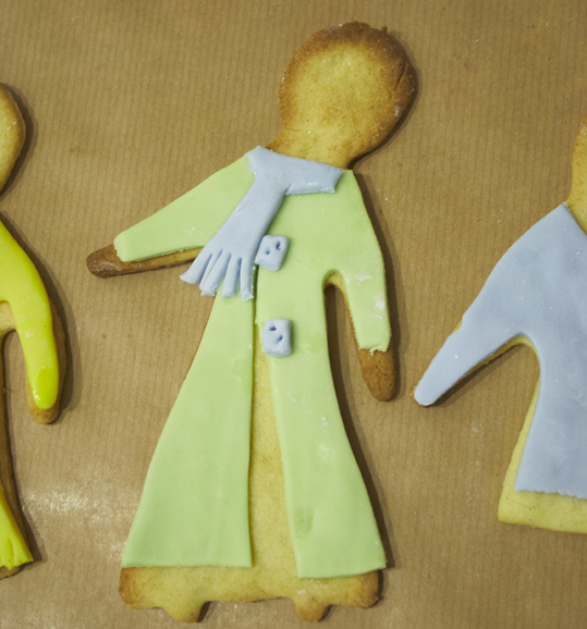 Picture of lemon biscuits with icing coats and scarves