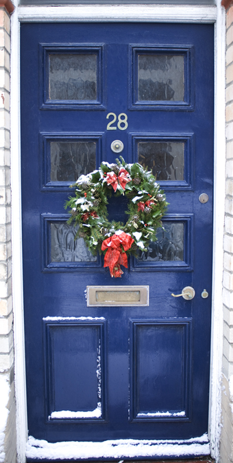 holly wreath on blue door