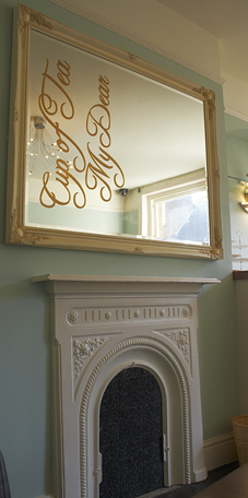Georgian style fireplace with mirror above including the words cup of tea my dear?