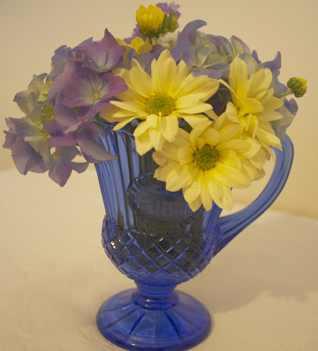 Victorian blue glass jug with blue and yellow flowers