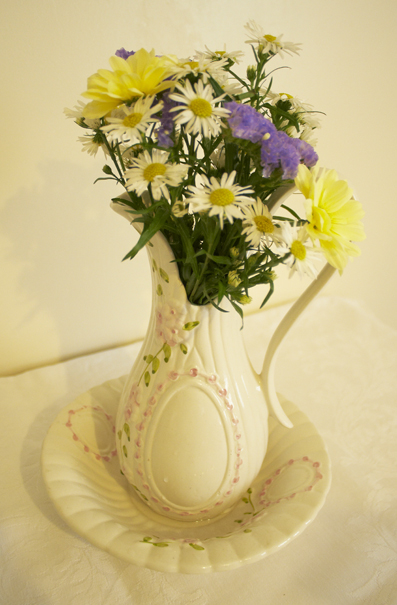 water jug of flowers