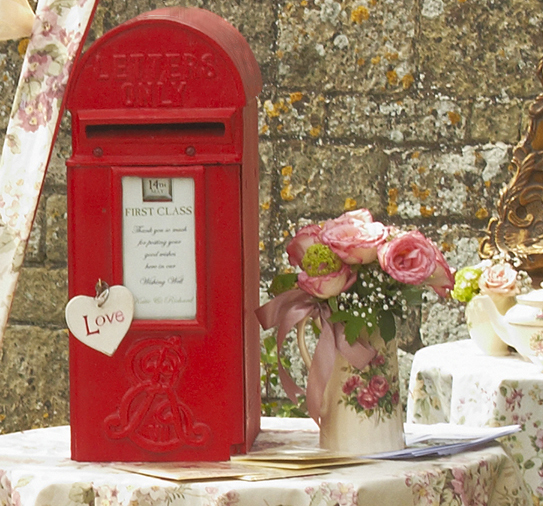 A red postbox wishing well