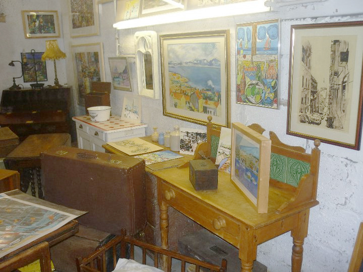 inside the curiosity centre - furniture and paintings