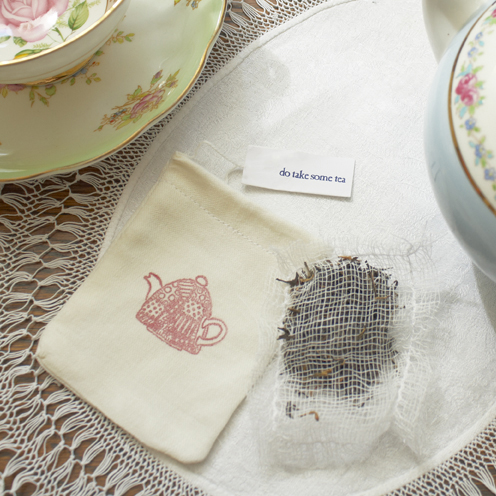 a muslin bag of loose leaf tea used as a wedding favor