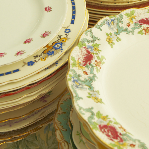 Vintage dinner plates stacked up