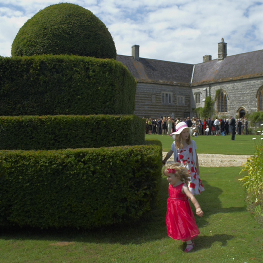 Children discovering the gardens at Higher Melcombe Manor wedding