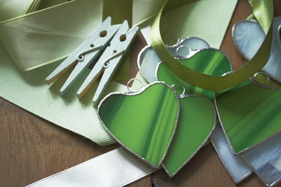 green hearts ribbons and pegs