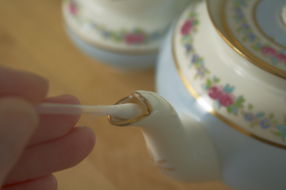 Cleaning the spout using a cotton bud