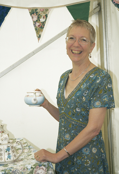 lady holding a vintage tea pot