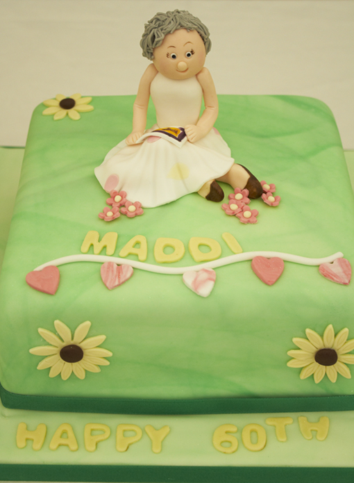 birthday cake showing a lady painting in a book