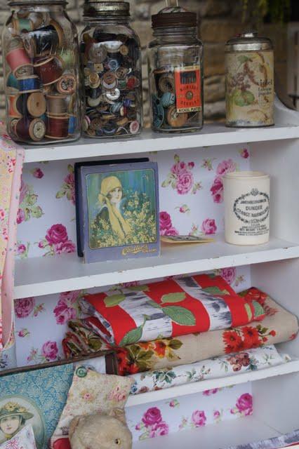 Vintage and handmade items on a shelf