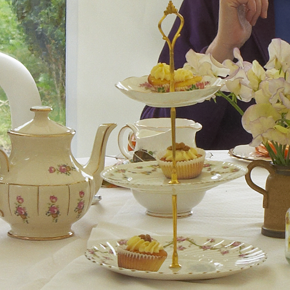 vintage teapot and vintage cakestand with a few cakes