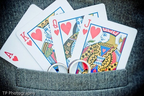 playing cards and wedding rings