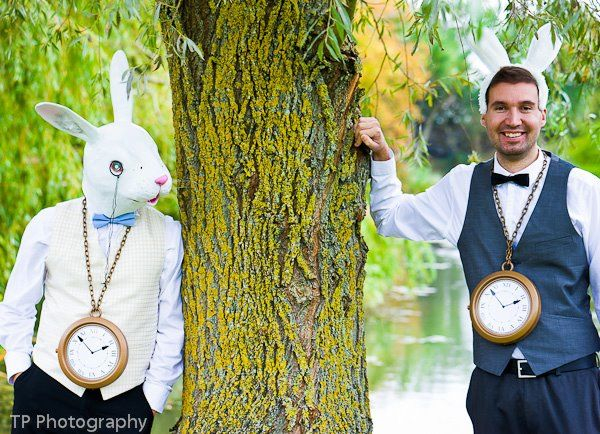 men dressed as white rabbit