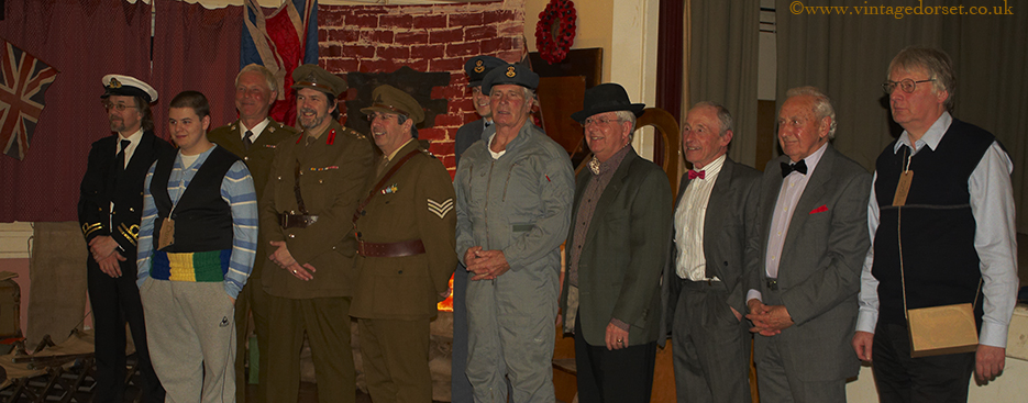 Men in uniforms and costumes at a Vintage Dorset Blitz party
